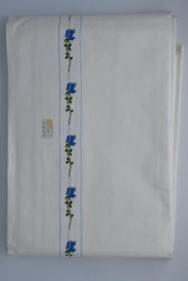 Wit boven- en onderlaken met strook blauwe bloemen